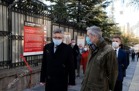 Polish diplomates wearing masks to help protect against the spread of coronavirus, speak during the opening of an open air photo exhibition about Lech Walesa, Polish statesman, dissident, and Nobel Peace Prize laureate, who served as the first democratically elected president of Poland from 1990 to 1995, and his Solidarity movement, in Ankara, Turkey, . Turkey's daily coronavirus deaths hit a record high as a series of restrictions aiming to slow the surge of COVID-19 infections came into effect