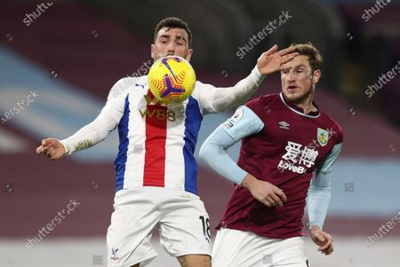 Stock Photo of Crystal Palace's James McArthur, left, duels for the ball with Burnley's Chris Wood during the English Premier League soccer match between Burnley and Crystal Palace at the Turf Moor stadium in Burnley, England