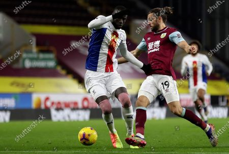 Stock Photo of Crystal Palace's Cheikhou Kouyate, left, duels for the ball with Burnley's Jay Rodriguez during the English Premier League soccer match between Burnley and Crystal Palace at the Turf Moor stadium in Burnley, England