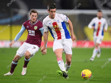 Stock Image of Crystal Palace's Scott Dann, right, duels for the ball with Burnley's Chris Wood during the English Premier League soccer match between Burnley and Crystal Palace at the Turf Moor stadium in Burnley, England