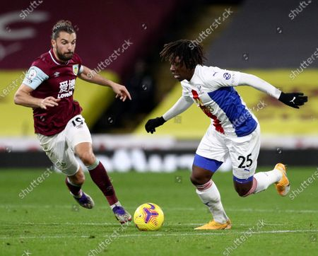 Crystal Palace's Eberechi Eze, right, duels for the ball with Burnley's Jay Rodriguez during the English Premier League soccer match between Burnley and Crystal Palace at the Turf Moor stadium in Burnley, England