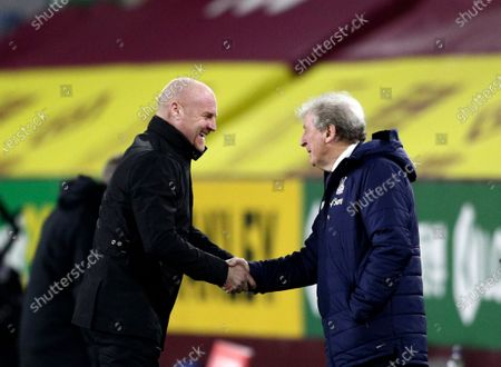 Burnley's manager Sean Dyche, left, shakes hands with Crystal Palace's manager Roy Hodgson before the English Premier League soccer match between Burnley and Crystal Palace at the Turf Moor stadium in Burnley, England