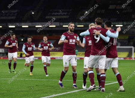 Burnley's Chris Wood celebrates with teammates after scoring his side's opening goal during the English Premier League soccer match between Burnley and Crystal Palace at the Turf Moor stadium in Burnley, England