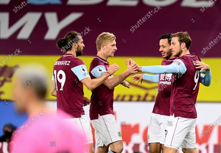 Burnley's Chris Wood, right, celebrates with teammates after scoring his side's opening goal during the English Premier League soccer match between Burnley and Crystal Palace at the Turf Moor stadium in Burnley, England