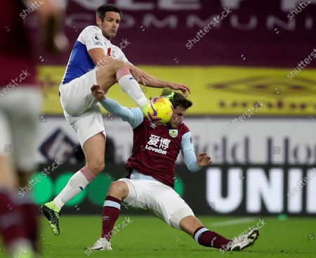 Burnley's Chris Wood, right, duels for the ball with Crystal Palace's Scott Dann during the English Premier League soccer match between Burnley and Crystal Palace at the Turf Moor stadium in Burnley, England