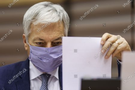 European Commissioner for Justice Didier Reynders, wearing a face mask ,arrives for a plenary session of the European Parliament, Belgium, 23 November 2020.