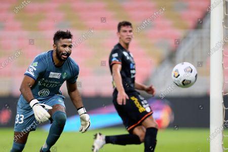 Al-Ahli's goalkeeper Mohammed Al-Owais (L) in action during the Saudi Professional League soccer match between Al-Ahli and Al-Shabab at King Abdullah Sport City Stadium, 30 kilometers north of Jeddah, Saudi Arabia, 23 November 2020.