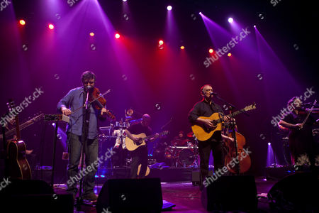 Stock Picture of Martin Carthy, Eliza Carthy, and Chris Wood, backed by a band featuring Simon Emmerson, Johnny Kalsi, Ali Friend, Andy Gangadeen, Simon Richmond, Sheema Mukherjee and Barney Morse Brown