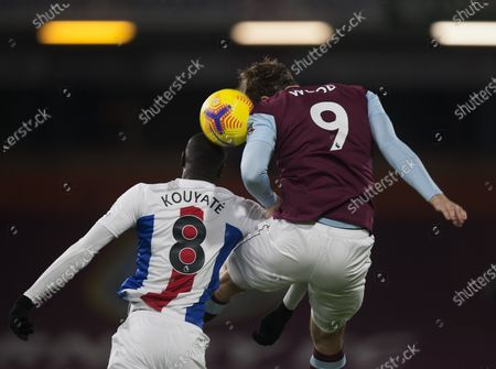 Cheikhou Kouyate of Crystal Palace (L) and Chris Wood of Burnley in action