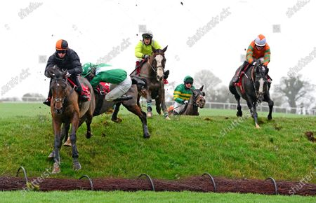 PUNCHESTOWN 24-November-2020. NEVERUSHACON and Paddy Kennedy (left) lands over Ruby's Double to go on and win for owners Exors of the Late David Reid Scott and trainer Jessica Harrington with jockey Kevin Sexton parting company with his mount HURRICANE DARWIN just behind. Healy Racing