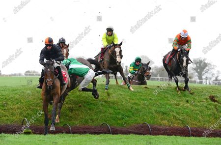 Stock Image of PUNCHESTOWN 24-November-2020. NEVERUSHACON and Paddy Kennedy (left) lands over Ruby's Double to go on and win for owners Exors of the Late David Reid Scott and trainer Jessica Harrington with jockey Kevin Sexton parting company with his mount HURRICANE DARWIN just behind. Healy Racing