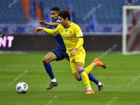 Al-Hilal's player Salman Al-Faraj (back) in action against Al-Nassr's Jin-su Kim (front) during the Saudi Professional League soccer match between Al-Hilal and Al-Nassr at King Fahd International Stadium, in Riyadh, Saudi Arabia, 23 November 2020.