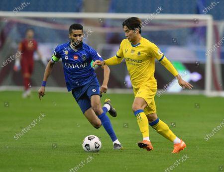 Al-Hilal's player Salman Al-Faraj (L) in action against Al-Nassr's Jin-su Kim (R) during the Saudi Professional League soccer match between Al-Hilal and Al-Nassr at King Fahd International Stadium, in Riyadh, Saudi Arabia, 23 November 2020.