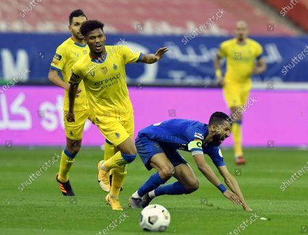 Al-Hilal's player Salman Al-Faraj (R) in action against Al-Nassr's Ayman Yahya (L) during the Saudi Professional League soccer match between Al-Hilal and Al-Nassr at King Fahd International Stadium, in Riyadh, Saudi Arabia, 23 November 2020.