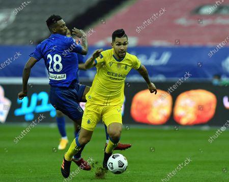 Al-Hilal's player Mohamed Kanno (L) in action against Al-Nassr's Petros (R) during the Saudi Professional League soccer match between Al-Hilal and Al-Nassr at King Fahd International Stadium, in Riyadh, Saudi Arabia, 23 November 2020.
