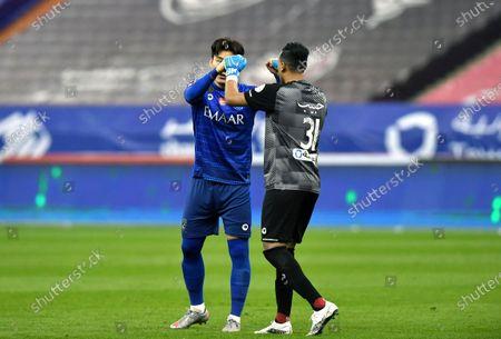 Al-Hilal's player Hyun Soo Jang (L) bumps fists with goalkeeper Habib Al-Wutaian (R) during the Saudi Professional League soccer match between Al-Hilal and Al-Nassr at King Fahd International Stadium, in Riyadh, Saudi Arabia, 23 November 2020.