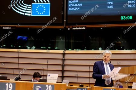 European Commissioner for Justice Didier Reynders speaks during a plenary session at the European Parliament, in Brussels