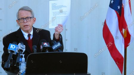 Republican Ohio Gov. Mike DeWine discusses the most recent data on Ohio's soaring coronavirus cases during a news briefing at John Glenn International Airport, in Columbus, Ohio. DeWine is facing criticism from some Republicans over his handling of the pandemic, including statewide mask orders and a ban on alcohol sales after 10 p.m., leading to speculation he could face a primary challenger in 2022