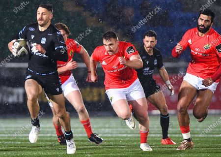 Stock Photo of Glasgow Warriors vs Munster. Glasgow's Tommy Seymour with Rory Scannell of Munster