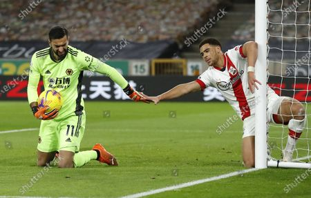 Rui Patricio (L) of Wolverhampton and Che Adams (R) of Southampton react during the English Premier League soccer match between Wolverhampton Wanderers and Southampton FC in Wolverhampton, Britain, 23 November 2020.
