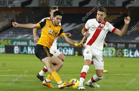 Raul Jimenez (L) of Wolverhampton in action against Jan Bednarek (R) of Southampton during the English Premier League soccer match between Wolverhampton Wanderers and Southampton FC in Wolverhampton, Britain, 23 November 2020.