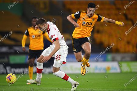 Raul Jimenez (R) of Wolverhampton in action against Jan Bednarek (L) of Southampton during the English Premier League soccer match between Wolverhampton Wanderers and Southampton FC in Wolverhampton, Britain, 23 November 2020.