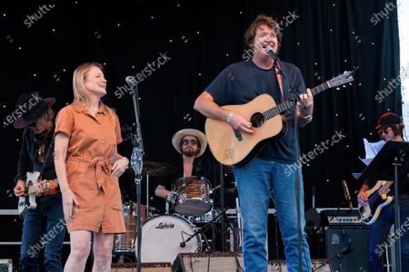 Kelly and Bruce Robison (front) perform with Charlie Sexcton, Josh Blue, and John Michael Schoepf at the Songs I Left Behind, a Tribute to Billy Joe Shaver, a Long Live Music event on the lawn at the Long Center