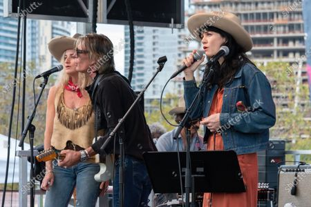 Molly Gayle Leary, Charlie Sexton, and Nikki Lane perform at the Songs I Left Behind, a Tribute to Billy Joe Shaver, a Long Live Music event on the lawn at the Long Center
