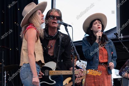 Stock Image of Molly Gayle Leary, Charlie Sexton, and Nikki Lane perform at the Songs I Left Behind, a Tribute to Billy Joe Shaver, a Long Live Music event on the lawn at the Long Center