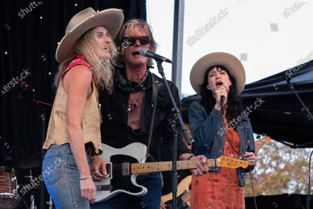 Stock Photo of Molly Gayle Leary, Charlie Sexton, and Nikki Lane perform at the Songs I Left Behind, a Tribute to Billy Joe Shaver, a Long Live Music event on the lawn at the Long Center