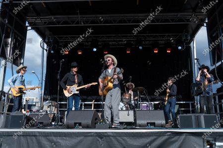 Ricky Ray Jackson, Charlie Sexton, Jonny Burke, Josh Blue, John Michael Schoepf, and Jonathan Terrell perform during the Songs I Left Behind, a Tribute to Billy Joe Shaver, a Long Live Music event on the lawn at the Long Center