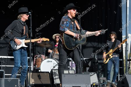 Charlie Sexton, Josh Blue, Jonathan Terrell, and John Michael Schoepf perform during the Songs I Left Behind, a Tribute to Billy Joe Shaver, a Long Live Music event on the lawn at the Long Center