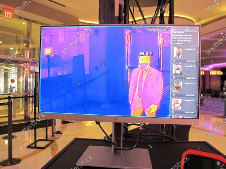Joe Lupo, president of the Hard Rock casino in Atlantic City, has his temperatures scanned by a thermal imagine camera at the entrance to the casino, as it reopened after 3 1/2 months of closures due to the coronavirus. On Nov. 23, 2020, New Jersey gambling regulators released figures showing Atlantic City's casinos saw their gross operating profits decline by 37% in the third quarter of 2020 as they reopened under restrictions designed to slow the spread of the virus