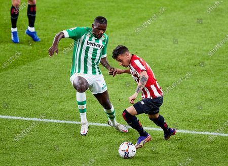 Alex Berenguer of Athletic Club and William Carvalho of Real Betis Balompie during the Spanish league, La Liga Santander, football match played between Athletic Club and Real Betis Balompie at San Mames stadium on November 23, 2020 in Bilbao, Spain.