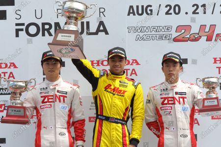 2016 Japanese Formula 3 Championship. Motegi, Japan. 20th - 21st August 2016. Rd 11 & 12. Round 12 Winner Jann Mardenborough ( #22 B-MAX NDDP F3 ) 2nd position Kenta Yamashita ( #36 ZENT TOM'S F312 ) 3rd position Sho Tsuboi ( #37 ZENT TOM'S F314 ) podium, portrait. World Copyright : Yasushi Ishihara/LAT Photographic Ref : 2016JF3_R11&12_015