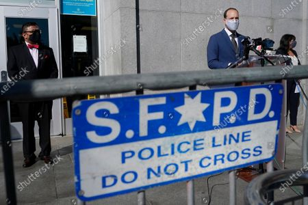 Stock Picture of San Francisco District Attorney Chesa Boudin, foreground right, speaks between the chief of staff David Campos, left, and assistant district attorney Rachel Marshall at a news conference in San Francisco, . A former San Francisco police officer, Chris Samayoa, who fatally shot an unarmed carjacking suspect in 2017 has been charged with manslaughter, Boudin said on Monday