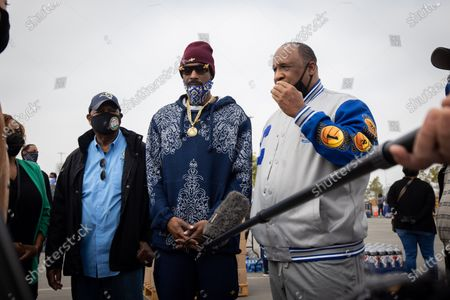 US rapper Snoop Dogg and local city officials speak to the press at a drive-thru Thanksgiving meal distribution in front of SoFi Stadium in Inglewood, California, USA, 23 November 2020. Some 2,500 families from Inglewood picked up free thanksgiving meals at a drive-thru in front of SoFi Stadium.