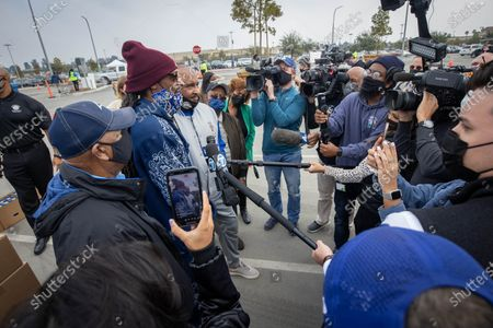 US rapper Snoop Dogg speaks to the press at a drive-thru Thanksgiving meal distribution in front of SoFi Stadium in Inglewood, California, USA, 23 November 2020. Some 2,500 families from Inglewood picked up free thanksgiving meals at a drive-thru in front of SoFi Stadium.