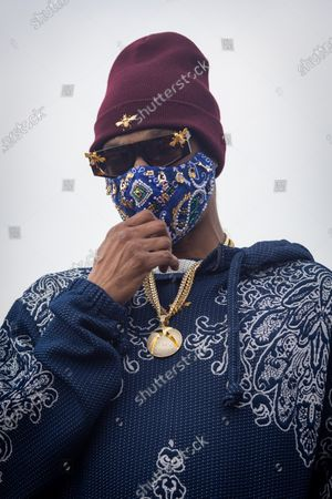 US rapper Snoop Dogg wears a mask at a drive-thru Thanksgiving meal distribution in front of SoFi Stadium in Inglewood, California, USA, 23 November 2020. Some 2,500 families from Inglewood picked up free thanksgiving meals at a drive-thru in front of SoFi Stadium.
