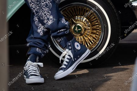 Stock Image of US rapper Snoop Dogg stands by his Chevrolet lowrider at a drive-thru Thanksgiving meal distribution in front of SoFi Stadium in Inglewood, California, USA, 23 November 2020. Some 2,500 families from Inglewood picked up free thanksgiving meals at a drive-thru in front of SoFi Stadium.