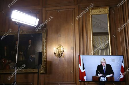 Britain's Prime Minister Boris Johnson appears on screen during a coronavirus news conference with Chief Medical Officer for England Chris Whitty and Director of the Oxford Vaccine Group Andrew Pollard giving an update about COVID-19 pandemic, at Downing Street in London, . Johnson is in quarantine after he came into contact with a confirmed coronavirus sufferer