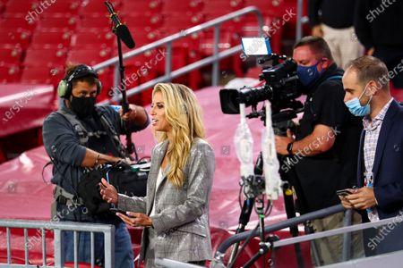 Network reporter Sara Walsh interviews players after an NFL Football game between the Los Angeles Rams and the Tampa Bay Buccaneers, in Tampa, Fla