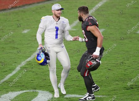 Los Angeles Rams kicker Matt Gay (1) shakes hands with Tampa Bay Buccaneers defensive end Pat O'Connor (79) during the second half of an NFL football game, in Tampa, Fla