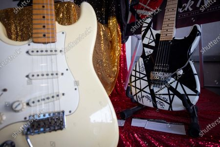 Guitars played by US musicians Jimi Hendrix, left, and Eddie Van Halen are displayed and put for auction at Julien's Auctions in Beverly Hills, California, USA, 23 November 2020. The auction will be held on 01 December 2020.