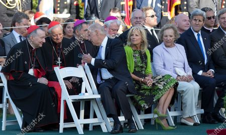 United States Vice President Joe Biden speaks with Catholic Cardinals as President Barack Obama hosts an Official State Welcome ceremony for Pope Francis on the South Lawn of the White House in Washington, DC on Wednesday, September 23, 2015. With Biden are Dr. Jill Biden, Ethel Kennedy and Secretary of State John Kerry