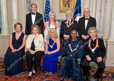 The five recipients of the 38th Annual Kennedy Center Honors pose for a group photo following a dinner hosted by United States Secretary of State John F. Kerry in their honor at the U.S. Department of State in Washington, D.C.. The 2015 honorees are: singer-songwriter Carole King, filmmaker George Lucas, actress and singer Rita Moreno, conductor Seiji Ozawa, and actress and Broadway star Cicely Tyson. From left to right top: United States Secretary of State John Kerry; Rita Moreno; George Lucas; and David M. Rubenstein, Chairman, John F. Kennedy Center for the Performing Arts. From left to right bottom: Deborah F. Rutter, President, John F. Kennedy Center for the Performing Arts; Teresa Heinz-Kerry; Carole King; Cicely Tyson; and Seiji Ozawa.