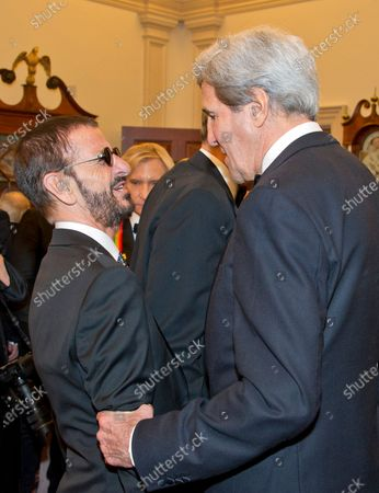 United States Secretary of State John Kerry speaks with Ringo Starr, left, following a dinner hosted by United States Secretary of State John F. Kerry in their honor at the U.S. Department of State in Washington, D.C.. The 2016 honorees are: Argentine pianist Martha Argerich; rock band the Eagles; screen and stage actor Al Pacino; gospel and blues singer Mavis Staples; and musician James Taylor.