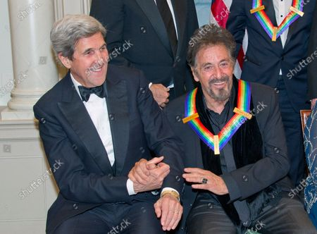 United States Secretary of State John Kerry, left, shakes hands with actor Al Pacino, right, as they prepare prepare to pose The five recipients of the 39th Annual Kennedy Center Honors pose for a group photo following a dinner hosted by United States Secretary of State John F. Kerry in their honor at the U.S. Department of State in Washington, D.C.. The 2016 honorees are: Argentine pianist Martha Argerich; rock band the Eagles; screen and stage actor Al Pacino; gospel and blues singer Mavis Staples; and musician James Taylor.