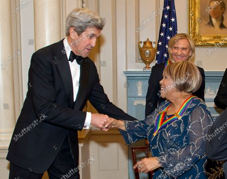 United States Secretary of State John Kerry shakes hands with blues singer Mavis Staples, one of the five recipients of the 39th Annual Kennedy Center Honors, after they posed for a group photo following a dinner hosted by United States Secretary of State John F. Kerry in their honor at the U.S. Department of State in Washington, D.C.. The 2016 honorees are: Argentine pianist Martha Argerich; rock band the Eagles; screen and stage actor Al Pacino; gospel and blues singer Mavis Staples; and musician James Taylor.