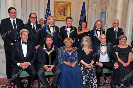 "The five recipients of the 39th Annual Kennedy Center Honors pose for a group photo following a dinner hosted by United States Secretary of State John F. Kerry in their honor at the U.S. Department of State in Washington, D.C.. The 2016 honorees are: Argentine pianist Martha Argerich; rock band the Eagles; screen and stage actor Al Pacino; gospel and blues singer Mavis Staples; and musician James Taylor. From left to right back row: Ricky Kirshner, Glenn Weiss, Joe Walsh, Don Henley, Cindy Frey, wife of Glenn Frey, who passed away earlier this year, and Timothy B. Schmidt of the rock band ""The Eagles"" and David M. Rubenstein, Chairman, John F. Kennedy Center for the Performing Arts. Front row, left to right: United States Secretary of State John Kerry, Al Pacino, Mavis Staples, Martha Argerich, James Taylor and Deborah F. Rutter, President of the John F. Kennedy Center for the Performing Arts."
